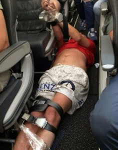 Man lies restrained in aisle on Siberia Airlines flight