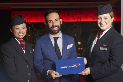 Tim Philips with British Airways ambassadors and his prize of a return Club World business class ticket to London
