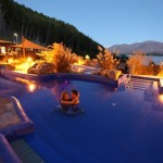 A couple enjoy a warm summers evening in the hot pool at Tekapo Springs_media