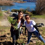 Planting native trees for Crowne Plaza Queenstown are (L to R) Duty Manager Olivia Leitch and Human Resources Manager Teah Pantano
