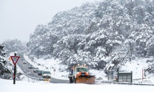 Snow plough clearing the road into Thredbo
