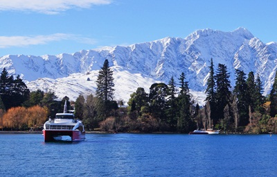Spirit-of-Queenstown-cruises-in-front-of-The-Remarkables-media
