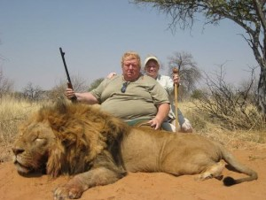 Western big game hunter with lion
