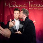 Singer Sam Smith, right, takes a selfie while unveiling his wax doppleganger in San Francisco, California, August 10, 2015. (Photo by Noah Berger for Madame Tussauds)