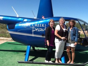 : TravelManagers' personal travel managers left to right Karen Doyle, Penny Meallin and Katy Hurd enjoy an adventurous helicopter ride over Willie Creek pearl farm on the North Western Australia mega famil.