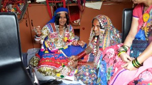 ladies making ethnic crafts at the display shop at the mart.