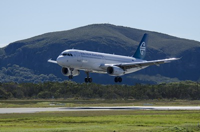 Air New Zealand plane with Sunshine Coast's Mt Coolum in the background