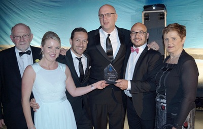 Best Cruise Operator Award Sponsor Tony Dominey, Tabs On Travel Celebrates with the Carnival New Zealand Team at the TAANZ Awards 2015