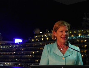 Carnival's Ann Sherry with Diamond Princess (and giant screen) in background