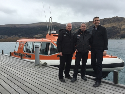 Neville Kelly Director Queenstown Water Taxis, Sir Eion Edgar regular user of the service, and Chris Ehmann GM The Hilton Hotel_media