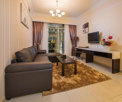 1BR with Living Room at Emirates Grand Hotel Apartments