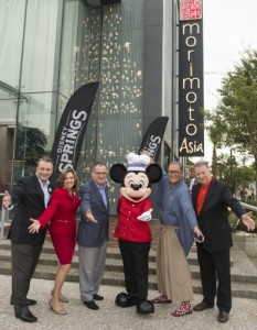 Disney Springs Vice President Keith Bradford, Disney Springs and ESPN Wide World of Sports Complex Senior Vice President Maribeth Bisienere, Walt Disney World Resort President George A. Kalogridis, Mickey Mouse, Chef Masaharu Morimoto and Patina Restaurant Group CEO Nick Valenti celebrate the opening of Morimoto Asia Sept. 29, 2015 at the newly named Disney Springs complex at Walt Disney World Resort in Lake Buena Vista, Fla. Re-imagined from Downtown Disney, Disney Springs is doubling the number of shopping, dining and entertainment experiences opening in phases through 2016. (David Roark, photographer). (PRNewsFoto/Walt Disney World Resort)