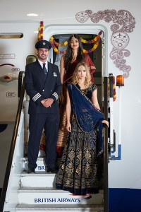 LONDON, ENGLAND - OCTOBER 24:  Suki Waterhouse and Nelham Gill pose during a photo shoot to mark the launch of  flights by  the new British Airways Boeing 787-9 Dreamliner from London to New Dehli at Heathrow Airport on October 24, 2015 in London, England. Suki Waterhouse  Nelham Gill wore traditional Indian outfits by DESIGNER TBC  (Photo by Eamonn M. McCormack/Getty Images for British Airways)