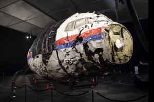 A supplied image obtained Wednesday, Oct. 14, 2015 of a reconstructed section of the Malaysia Airlines plane that was downed by a missile over Ukraine, killing 298 people at the Gilze-Rijen Air Force Base, the Netherlands on Wednesday. Parts of the cockpit and business class were reconstructed from wreckage retrieved from Ukraine and brought to the Netherlands where the crash investigation was based. (AAP Image/Dutch Safety Board) NO ARCHIVING, EDITORIAL USE ONLY