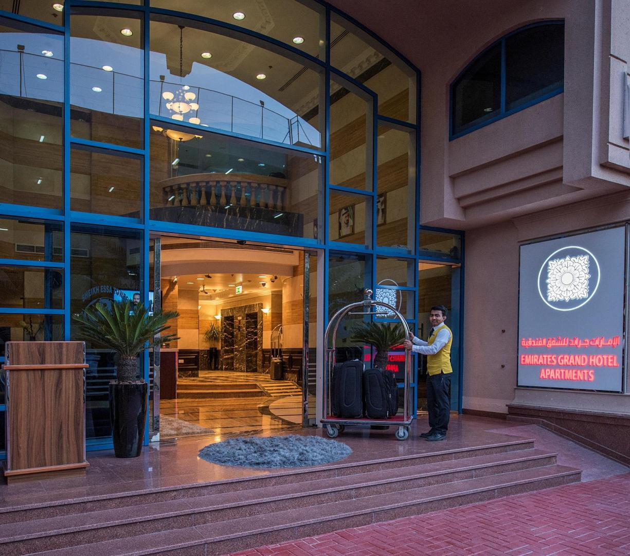 Hotel Entrance at Emirates Grand Hotel Apartments