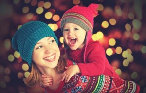 happy family mother and baby little daughter playing in the winter for the Christmas holidays; Shutterstock ID 223295863; user id: 12929698; user email: luang@wondershare.cn; user_country: China; discount: 16%