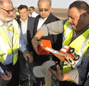 Egyptian official at crash site holds flight recorder from doomed flight