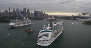 Explorer of the Seas and Voyager of the Seas sail past with Fort Denison in the middle, providing scale