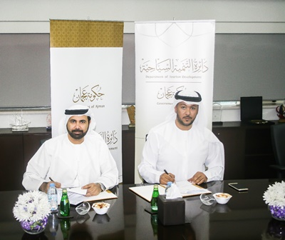 HE Ali Issa Al Nuaimi, Director General of Ajman DED and HE Faisal Al Nuaimi, General Manager of ATDD sign the agreement