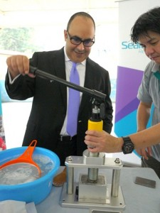 Mr. Hafidh Al Busaidy, General Manager of InterContinental Kuala Lumpur hotel trying his hands at recycling used hotel soaps using innovative cold-press method..