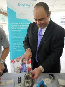 Mr. Hafidh cutting the hotel's  recycled Argaria bar soap, an estimated of solid soap may be recycled each year through the partnership..