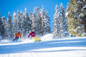 Amie Engerbretson and Adam Moszynski Skiin on a Sunny day at Aspen Highlands in Colorado