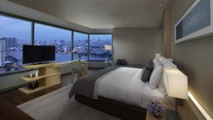 AVANI Riverside Bangkok_River_View_Junior_Suite_Twilight_with_view