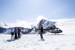 Passengers enjoying a trip to the Tutoko Glacier on Over the Top's new twin-engine helicopter