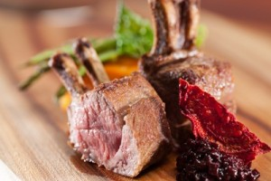 Roasted lamb rack with, sweet potato cake, beetroot relish and red wine jus