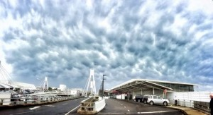 Unearthly looking clouds gather over Sydney Airport