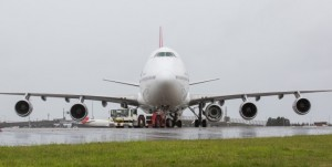 Qantas B747 prepares to fly from Sydney to South Africa with a fifth Rolls Royce engine under its left wing. Photo, Qantas and YouTube