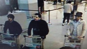 Belgian media circulated this CCTV image of suspected suicide bombers at Brussels airport before the blasts. The man in white at right is thought to have escaped when his bomb did not go off.