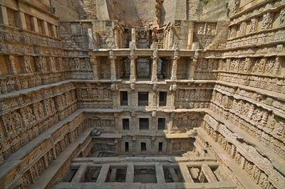 Ornate stone carved walls lining the 11th century Rav-Ki-Vav stepwell at Patan, Gujarat, India