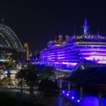 Queen Victoria illuminated in purple at Sydney's Circular Quay for International Women's Day 2016 Credit - James Morgan