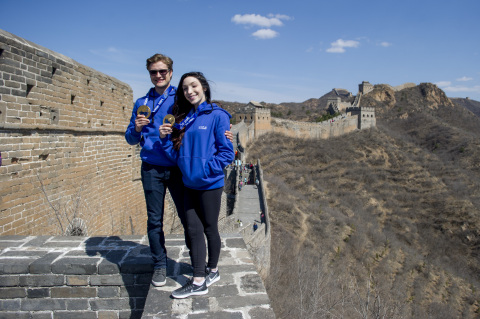 U.S Olympic gold medalist and Team Visa athletes Meryl Davis and Charlie White, pose with their gold medals at the Great Wall. They led a delegation of 1,000 U.S visitors in a climb of the Jinshaling section of the Great Wall, on March 25, 2016. Davis and White are working with Visa, a sponsor of the 2016 U.S - China Tourism Year, in an effort to boost tourism, business and understanding between China and the U.S. Photo Credit: AP/Stefen Chow