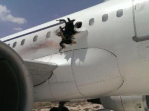 The plane after landing. Blast hole shows explosion happened inside cabin.