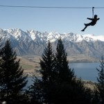 A guest enjoying the view of Queenstown while 'zipping' through the tree...