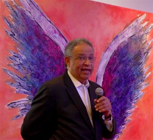 Colette Miller's Angel Wings provide a backdrop for Discover Los Angeles chief executive, Ernie Wooden Jr, in Sydney