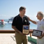 David James, Director - Tangalooma Wild Dolphin Resort (left) and Carnival Spirit's Captain Adriano Binacchi.