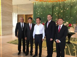 Mr. Maurice Cook, Mr. Qian Jin, Mr. WangJianlin, Mr. Christophe Lauras, Mr.Simon Tian(From Left to Right)