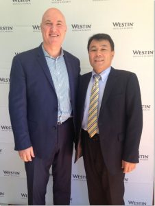 From left to right: Sean Hunt, Vice President of Starwood Hotels & Resorts Pacific shakes hands with Toru Abe, CEO & Managing Director, Sekisui House Australia