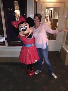 TravelManagers' personal travel manager Louise McCarthy all smiles with Minnie Mouse at Disneyland