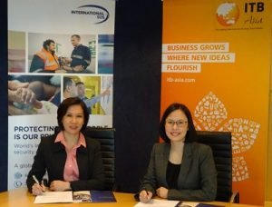Ms. Juliana Gim, Managing Director of International SOS Singapore and Ms. Katrina Leung, Executive Director of Messe Berlin (Singapore) at the official signing ceremony