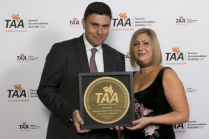 Peter Crinis from Crown Towers accepts award for Deluxe Hotel of the Year from The Age's Marina Caccavari