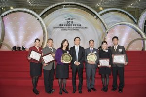 "Staff from Cathay Pacific and Hong Kong Airport Services Limited win ""Best Customer Service of the Year"" in the ""Cross-Company Excellence Award."""