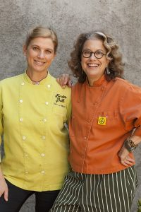Chefs Susan Feniger (Orange Coat) and Mary Sue Milliken (Yellow Coat) photographed at Mary Sue Milliken's home in Culver City, CA.  The two chefs are the owners of Border Grill in Los Angeles.