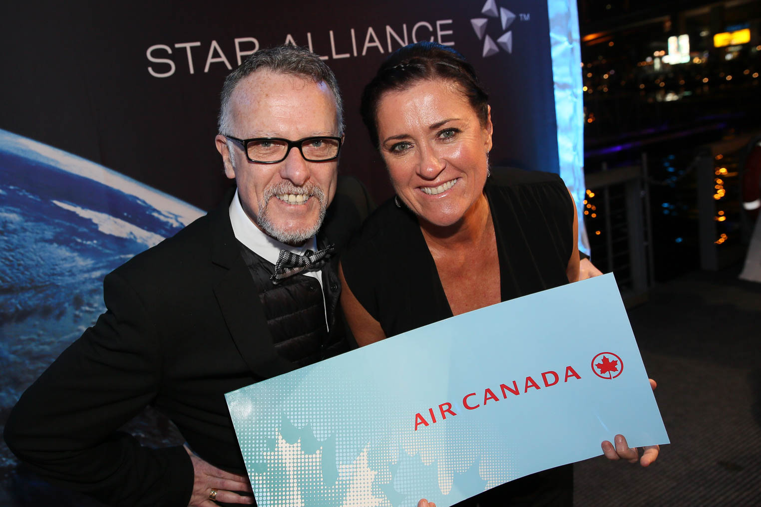 Star Alliance_1_ Scratch and Win_Rick Pomery (Air Canada) and Margaret Sibraa (Intrepid Group)