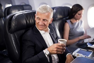 illy CEO Andrea Illy enjoys a cup of United's illy dark roast