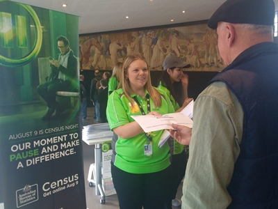 Census staffer Christina Hill hands out a Census pack to a Pacific Jewel guest at the OPT Sydney
