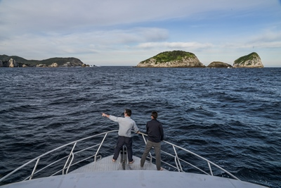 Guide & guest island spotting from the bow of Odalisque